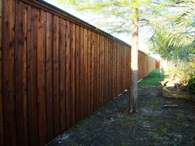 ecofencing company - long wood fence around perimeter