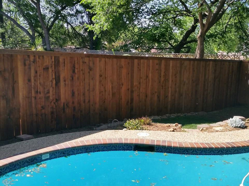ecofencing company - wood fence at pool area