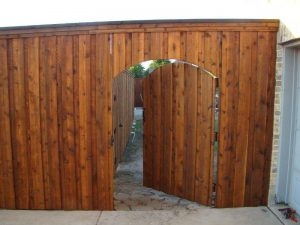 ecofencing company - wood fence with a door