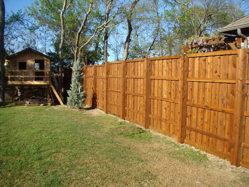 ecofencing company - wood fence with tree house