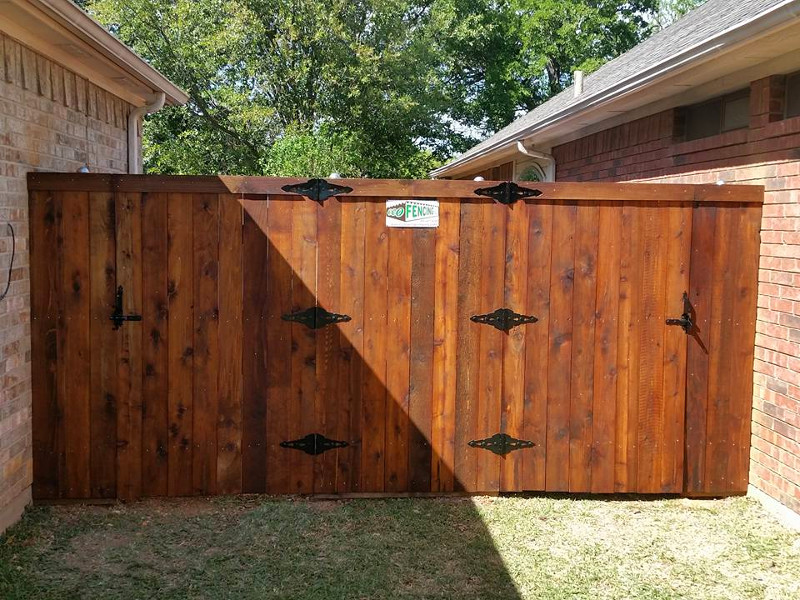 ecofencing company - wood fence with two gates shared by neighbors