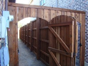 ecofencing company - wood fence with two doors shared by two neighbors